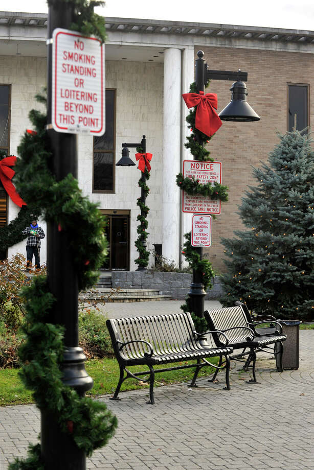 Signs remind people to refrain from loitering, standing or smoking in Library Plaza in Danbury on Tuesday, Dec. 11, 2012. Mayor Mark Boughton has proposed playing loud classical music ini the plaza to discourage vagrancy. Photo: Jason Rearick / The News-Times