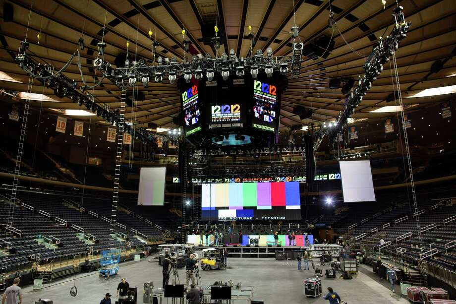 "Workers prepare Madison Square Garden for the ""12-12-12"" concert whose proceeds will aid the victims of Superstorm Sandy, Tuesday, Dec. 11, 2012, in New York. The Dec. 12 concert will feature artists Bon Jovi, Eric Clapton, Dave Grohl, Billy Joel, Alicia Keys, Chris Martin, The Rolling Stones, Bruce Springsteen & the E Street Band, Eddie Vedder, Roger Waters, Kanye West, The Who and Paul McCartney. Photo: John Minchillo"