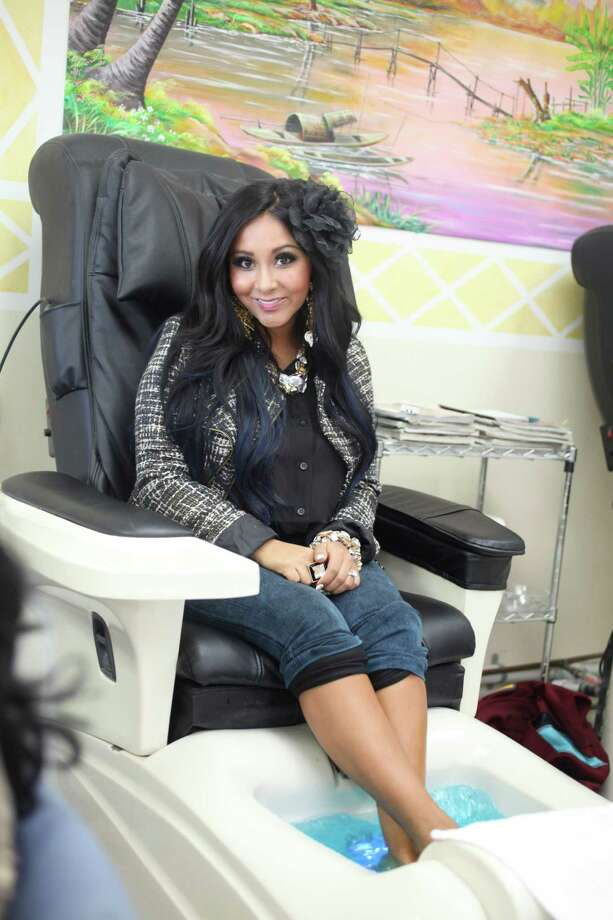 "Nicole ""Snooki"" Polizzi, a cast member of ""Jersey Shore,"" gets a pedicure at Nail Show in East Hanover, N.J., Oct. 23, 2012. After six seasons ""Jersey Shore"" is coming to an end and its showboating cast contemplates life beyond the reality-TV camera. PHOTO MOVED IN ADVANCE AND NOT FOR USE - ONLINE OR IN PRINT - BEFORE DEC. 09, 2012. Nicole ""Snooki"" Polizzi, a cast member of ""Jersey Shore,"" gets a pedicure at Nail Show in East Hanover, N.J., Oct. 23, 2012. After six seasons ""Jersey Shore"" is coming to an end and its showboating cast contemplates life beyond the reality-TV camera. (Chester Higgins Jr./The New York Times) -- PHOTO MOVED IN ADVANCE AND NOT FOR USE - ONLINE OR IN PRINT - BEFORE DEC. 09, 2012. -- Photo: Chester Higgins Jr., STF"