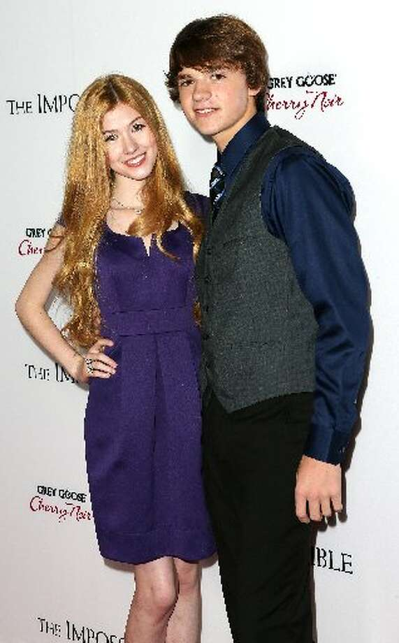 Actress Katherine McNamara (L) and actor Joey Courtney attend the Premiere Of Summit Entertainment's The Impossible at the ArcLight Cinerama Dome on December 10, 2012 in Hollywood, California. (Photo by Frederick M. Brown/Getty Images) (Getty)