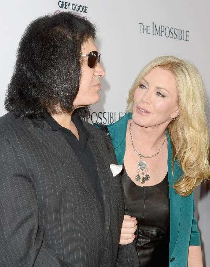 Musician Gene Simmons (L) and Shannon Tweed attend the Los Angeles premiere of Summit Entertainment's The Impossible at ArcLight Cinemas Cinerama Dome on December 10, 2012 in Hollywood, California. (Photo by Jason Merritt/Getty Images) (Getty)