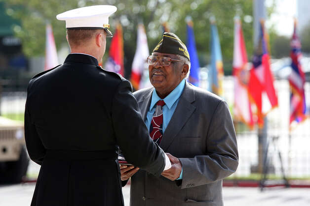World War II veteran Calvin Curtis, 87, receives the Congressional Gold Medal from Marine Lt. Col. Bruce Sotire during a ceremony at Fort Sam Houston. Photo: Jerry Lara, San Antonio Express-News / © 2012 San Antonio Express-News