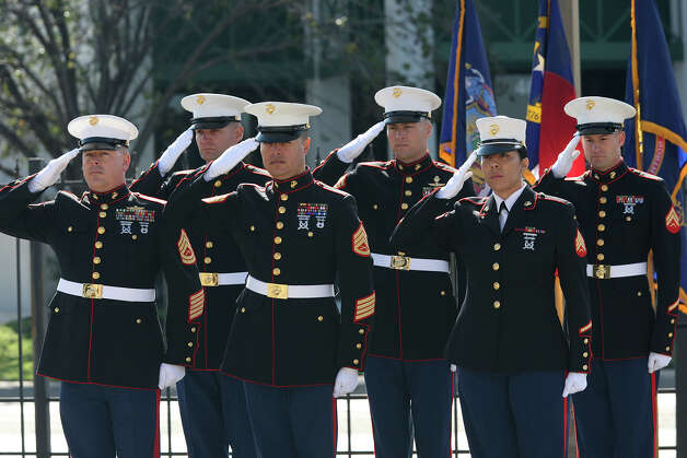 U.S. Marines salute the flag during a ceremony for World War II veteran Calvin Curtis, 87, at Fort Sam Houston, Tuesday, Dec. 11, 2012. Calvin received the Congressional Gold Medal during the ceremony. He was a member of the Montfort Point Marines, the nation's first black Marines. Photo: Jerry Lara, San Antonio Express-News / © 2012 San Antonio Express-News
