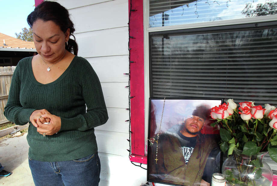 Dolores Viesca looks at an engagement ring Terrell Stephens (whose photo is at right) had planned to give her for Christmas. Photo: JOHN DAVENPORT, San Antonio Express-News / ©San Antonio Express-News/Photo Can Be Sold to the Public
