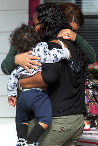 Viesca hugs Belyn Stephens, who's also holding her 1-year-old son, Leo Lopez. The encounter on the front porch of the home  of Stephens' mother  was the  two women's first meeting. Photo: JOHN DAVENPORT, San Antonio Express-News / ©San Antonio Express-News/Photo Can Be Sold to the Public