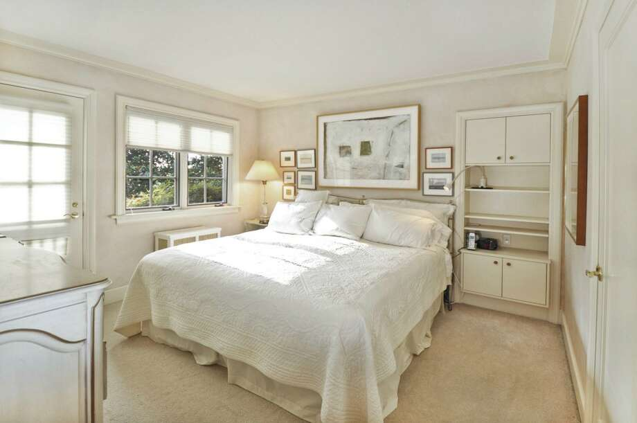 Master bedroom of 3610 W. Laurelhurst Drive N.E. The 3,450-square-foot Tudor, built in 1926, has three bedrooms, three bathrooms, leaded glass, French doors, a lower-level rec room, and multiple decks and patios on a 7,200-square-foot lot. It's listed for $1.192 million. Photo: Cora Brown/Courtesy Helen Senseney, Quorum-Laurelhurst, Inc.