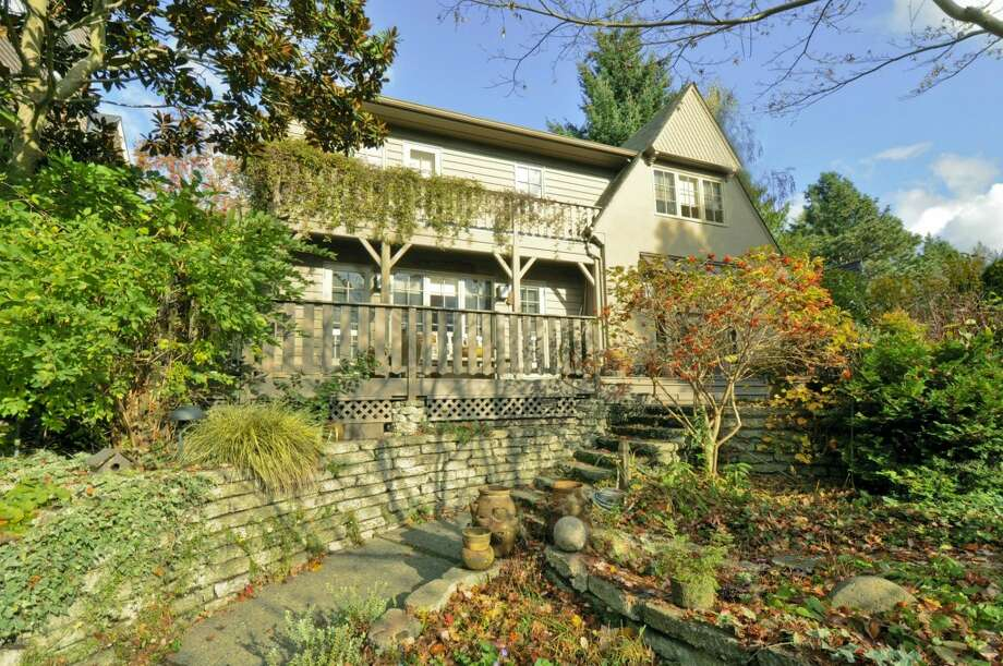 Want to get your loved one a $1 million Christmas gift? How about a luxury home in Seattle's posh Laurelhurst neighborhood? Here are a couple of options, starting with 3610 W. Laurelhurst Drive N.E. The 3,450-square-foot Tudor, built in 1926, has three bedrooms, three bathrooms, leaded glass, French doors, a lower-level rec room, and multiple decks and patios on a 7,200-square-foot lot. It's listed for $1.192 million. Photo: Cora Brown/Courtesy Helen Senseney,  Quorum-Laurelhurst,  Inc.