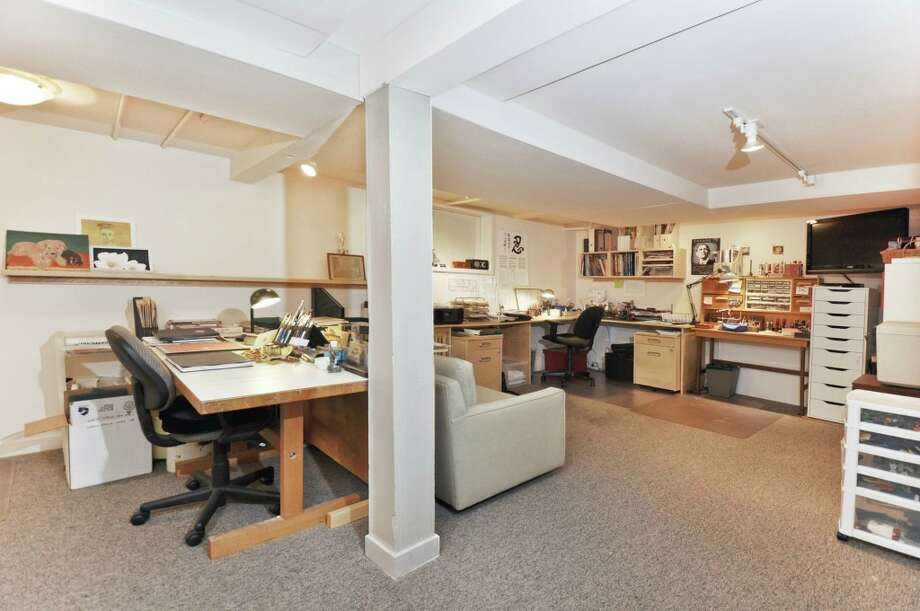 Lower-level rec room of 3610 W. Laurelhurst Drive N.E. The 3,450-square-foot Tudor, built in 1926, has three bedrooms, three bathrooms, leaded glass, French doors, and multiple decks and patios on a 7,200-square-foot lot. It's listed for $1.192 million. Photo: Cora Brown/Courtesy Helen Senseney, Quorum-Laurelhurst, Inc.