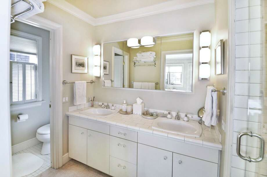 Bathroom of 3610 W. Laurelhurst Drive N.E. The 3,450-square-foot Tudor, built in 1926, has three bedrooms, three bathrooms, leaded glass, French doors, a lower-level rec room, and multiple decks and patios on a 7,200-square-foot lot. It's listed for $1.192 million. Photo: Cora Brown/Courtesy Helen Senseney, Quorum-Laurelhurst, Inc.