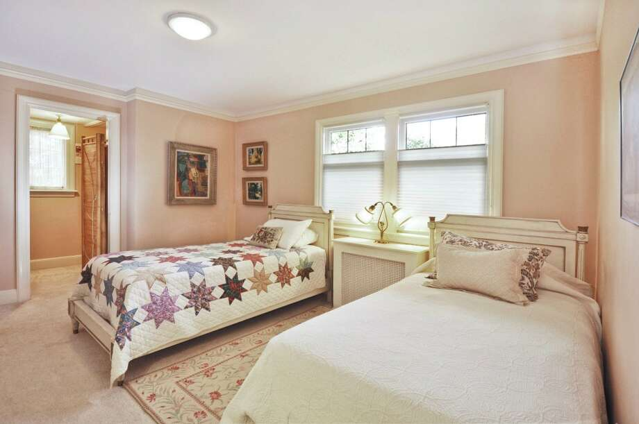 Bedroom of 3610 W. Laurelhurst Drive N.E. The 3,450-square-foot Tudor, built in 1926, has three bedrooms, three bathrooms, leaded glass, French doors, a lower-level rec room, and multiple decks and patios on a 7,200-square-foot lot. It's listed for $1.192 million. Photo: Cora Brown/Courtesy Helen Senseney, Quorum-Laurelhurst, Inc.