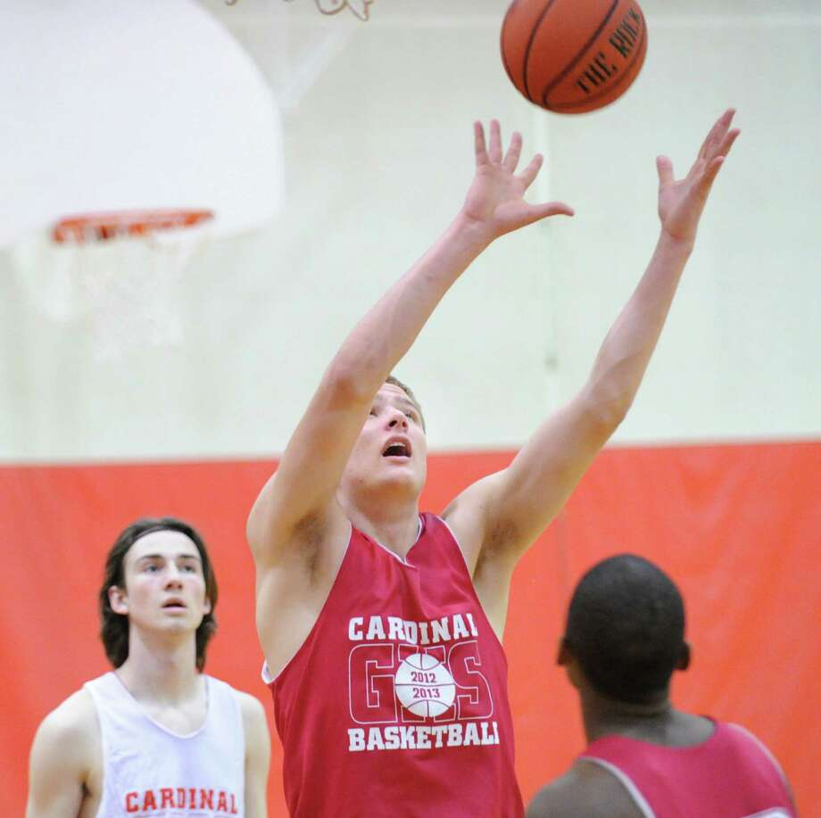 Alex Wolf, a 6-foot-9-inch junior, grabs a rebound during Greenwich High School boys basketball practice at the school, Tuesday afternoon, Dec. 11, 2012. Photo: Bob Luckey / Greenwich Time