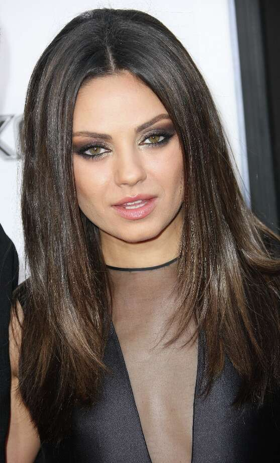 AskMen.com agreed with Esquire magazine. Mila Kunis, who was named the magazine's sexiest woman of the year, came in at 2 on this poll.  (Photo by Frederick M. Brown/Getty Images) Photo: Frederick M. Brown, Getty Images / 2012 Getty Images