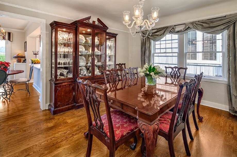 Dining room of 4314 N.E. 42nd St. The 3,020-square-foot Tudor, built in 1931, has three bedrooms, 2.5 bathrooms, French doors, leaded glass, coved ceilings, a family room, a basement rec room, a balcony, a deck and a patio on a 4,000-square-foot lot. It's listed for $1.05 million. Photo: Courtesy Kim And Brad Knowles/Windermere Real Estate