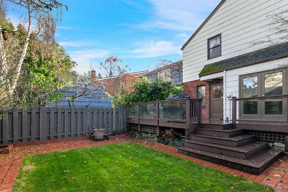 Backyard, with deck and patio, of 4314 N.E. 42nd St. The 3,020-square-foot Tudor, built in 1931, has three bedrooms, 2.5 bathrooms, French doors, leaded glass, coved ceilings, a family room and a basement rec room on a 4,000-square-foot lot. It's listed for $1.05 million. Photo: Courtesy Kim And Brad Knowles/Windermere Real Estate