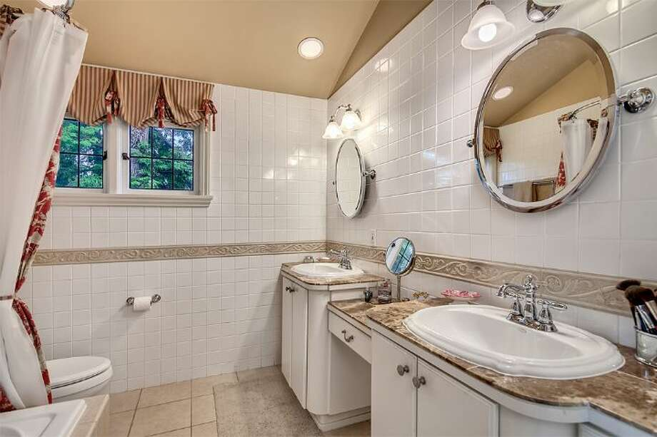 Master bathroom of 4314 N.E. 42nd St. The 3,020-square-foot Tudor, built in 1931, has three bedrooms, 2.5 bathrooms, French doors, leaded glass, coved ceilings, a family room, a basement rec room, a balcony, a deck and a patio on a 4,000-square-foot lot. It's listed for $1.05 million. Photo: Courtesy Kim And Brad Knowles/Windermere Real Estate