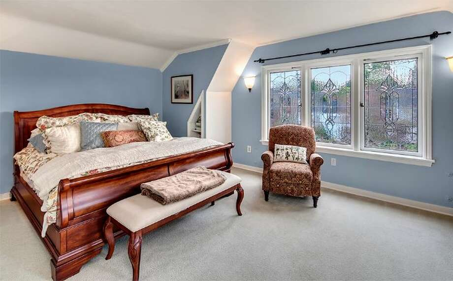 Master bedroom of 4314 N.E. 42nd St. The 3,020-square-foot Tudor, built in 1931, has three bedrooms, 2.5 bathrooms, French doors, leaded glass, coved ceilings, a family room, a basement rec room, a balcony, a deck and a patio on a 4,000-square-foot lot. It's listed for $1.05 million. Photo: Courtesy Kim And Brad Knowles/Windermere Real Estate