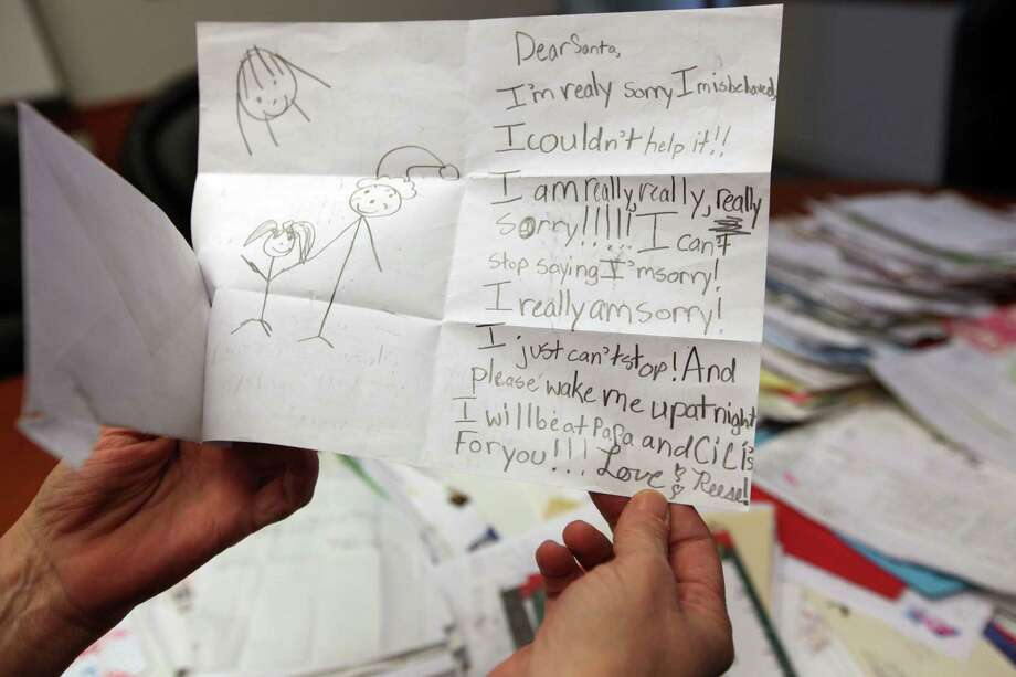 Children's letters to Santa are read and sorted to see if someone can adopt a letter for a child that is asking for basic needs for Christmas on Tuesday, Dec. 11, 2012, in Houston. Photo: Mayra Beltran, Houston Chronicle / © 2012 Houston Chronicle