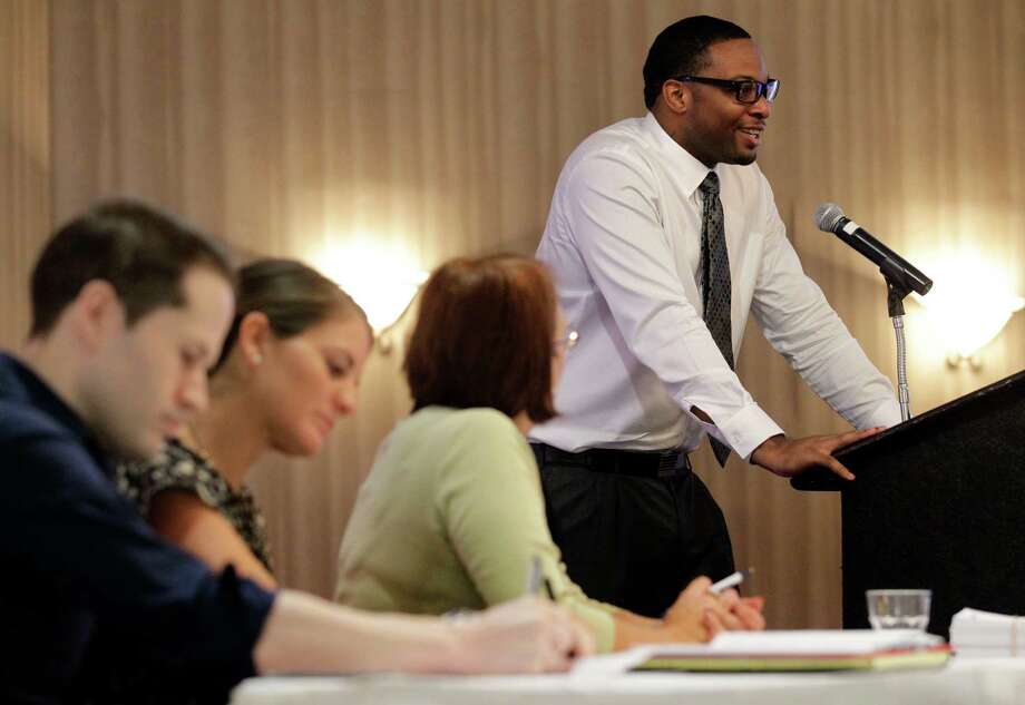 In this Thursday, Oct. 11, 2012, photo, a panel of Spirit Airlines employees make notes and listen as applicant Anthony Williams, top right, addresses a room full at a Flight Attendant Open House, in Dallas. The airline announced that it is hiring 250 positions that include flight attendants, pilots and mechanics to be based out of its newly announced crew base at Dallas-Fort Worth International Airport.  U.S. employers advertised more job in October than September, a hopeful sign that hiring could pick up in the coming months. (AP Photo/Tony Gutierrez) Photo: Tony Gutierrez