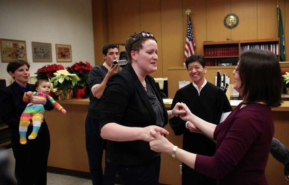 Sarah Cofer, left, and Emily Cofer, both of Arlington, are married just 
