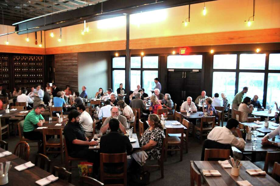 "The Underbelly dining room draws plenty of eaters. A survey ranks Houston No. 1 in the category of ""variety of dining options."" Photo: Dave Rossman, Freelance / © 2012 Dave Rossman"
