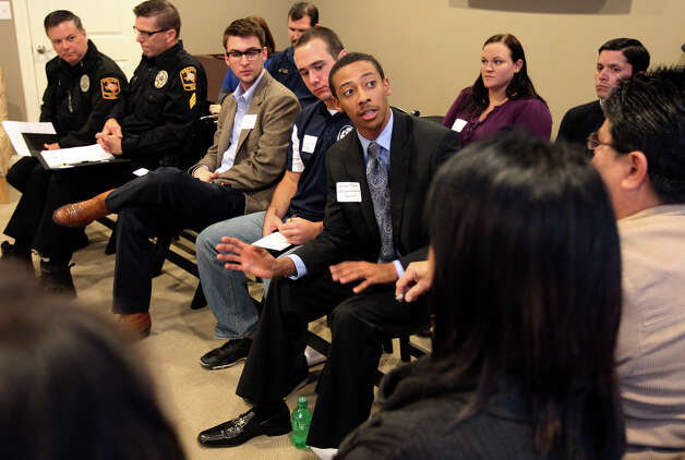 UTSA Student Government President Xavier Johnson speaks at a community meeting at Aspen Heights to discuss ideas about how to deal with growth-related problems like crime and traffic in neighborhoods around UTSA on Tuesday, Dec. 11, 2012. Photo: Kin Man Hui, San Antonio Express-News / © 2012 San Antonio Express-News