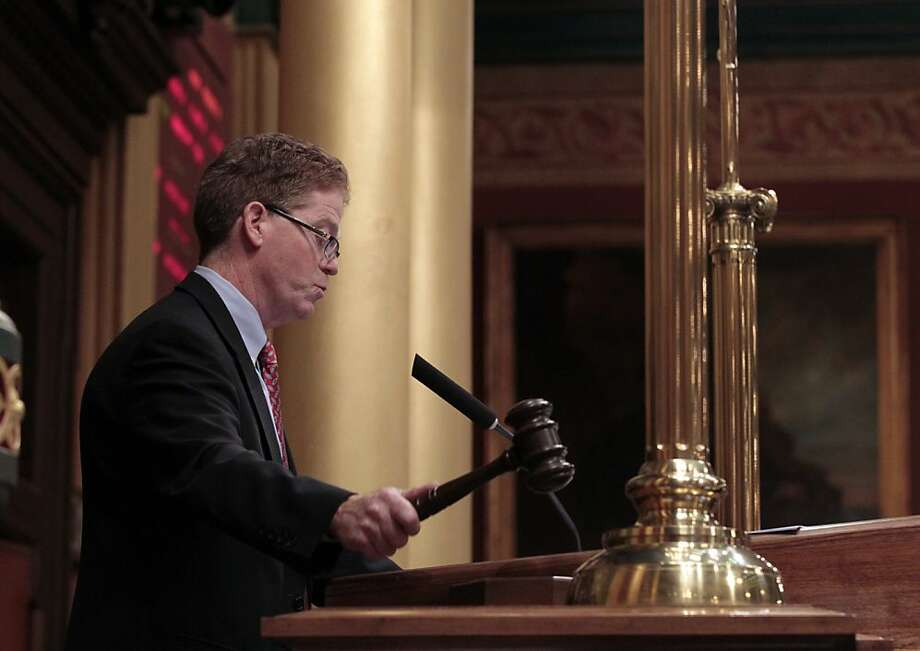 John J. Walsh, speaker pro tempore of the Michigan House of Representatives, slams the gavel after the final vote for H.B. 4003, one of the right-to-work bills, at the Capitol in Lansing, Michigan, U.S., on Tuesday, Dec. 11, 2012. Michigan lawmakers approved bills to prohibit mandatory union dues in workplaces as thousands of chanting protesters thronged the Capitol. Photographer: Jeff Kowalsky/Bloomberg *** Local Caption *** John J. Walsh Photo: Jeff Kowalsky, Bloomberg