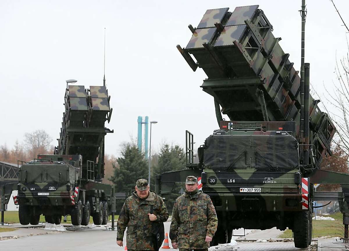 Soldiers of the Air Defence Missile Squadron 2 walk past Patriot missile launchers in the background in Bad Suelze, northern Germany on December 4, 2012. Russian President Vladimir Putin warned that any deployment of US-made Patriot missiles on Turkey's volatile border with war-ravaged Syria would exacerbate tensions, and said the two countries had failed to overcome their sharp differences on the conflict.