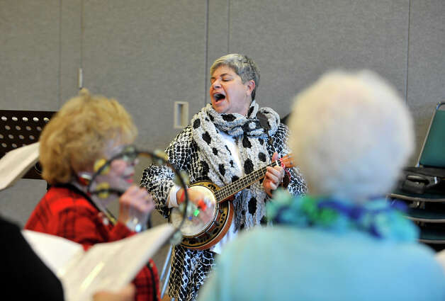 Reet Lubin leads the the SilverTones' practice at the Danbury Senior Center on Tuesday, Dec. 11, 2012. The SilverTones will be performing at 4 p.m. at St. James Church on First Night. Photo: Jason Rearick / The News-Times