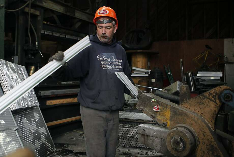 John McDermott cuts long strips of metal at San Francisco Scrap Metal in Potrero Hill. Photo: Paul Chinn, The Chronicle