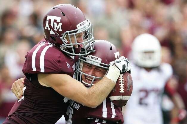 Texas A&M quarterback Johnny Manziel (2) celebrates with wide receiver Ryan Swope (25) after connecting on a touchdown pass against Arkansas during the first half of a college football game at Kyle Field, Saturday, Sept. 29, 2012, in College Station. Photo: Karen Warren, Houston Chronicle / © 2012  Houston Chronicle