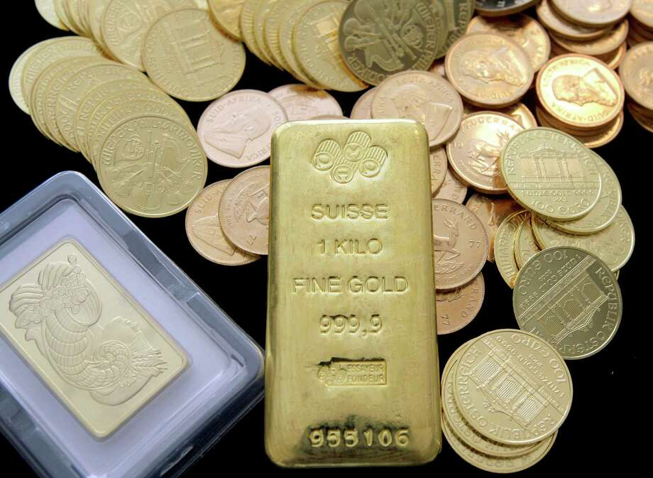 In this March 13, 2008 file photo, gold coins and bars are shown at California Numismatic Investments in Inglewood, Calif. Photo: Nick Ut, Associated Press / AP2008