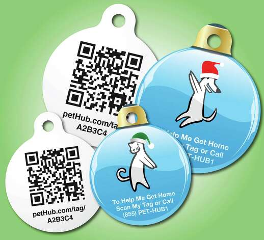 This undated image provided by PetHub shows a PetHub dog tag.  If your dog gets lost, anyone can scan this tag on a cell phone using a QR (quick response) scanning app and immediately get access to the dog owner's name, address and phone number. Photo: Associated Press / Associated Press
