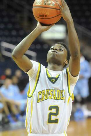 Trinity's Schadrac Casimir in action as Trinity Catholic and Archbishop Molloy face off in the Northeast Basketball Christmas Classic at Harbor Yard's Webster Bank Arena in Bridgeport, Conn., December 28, 2011. Photo: Keelin Daly / Stamford Advocate
