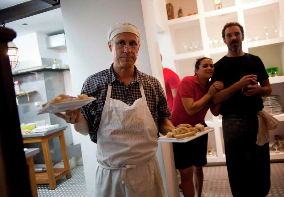 """American chefs Steve Sullivan, left, and Charlie Hallowell, were part of the """"Planting Seeds"""" delegation trying to expose Cubans to healthier, fresher dishes. Photo: Ramon Espinosa, STF / AP"""