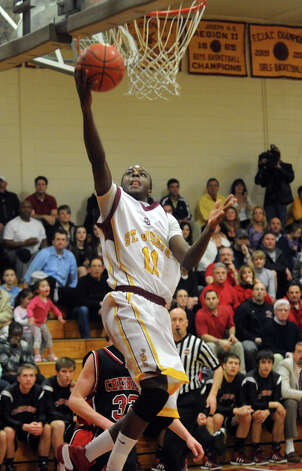 St. Joe's #11 Quincy McKnight lays up the ball, during CIAC Boys' Basketball State Tournament Class LL action against Cheshire in Trumbull, Conn. on Thursday March 8, 2012. Photo: Christian Abraham / Connecticut Post