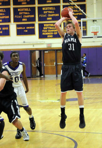 Staples' Peter Rankowitz takes a shot during Friday's game at Westhill High School on February 3, 2012. Photo: Lindsay Niegelberg / Stamford Advocate