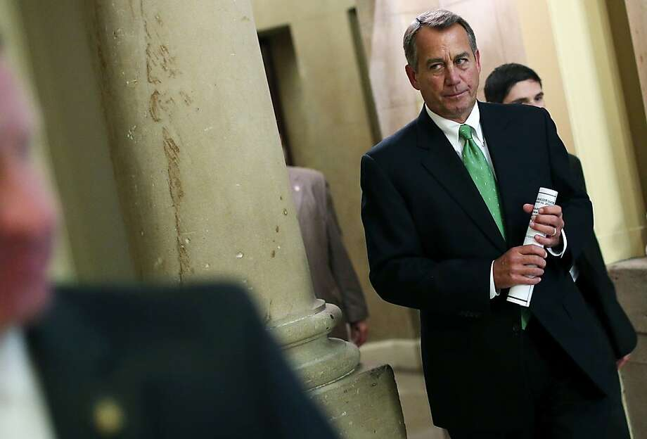 Speaker of the House John Boehner walks to the House chamber to discuss his negotiations with President Obama on tax increases and spending cuts. The two remain deadlocked. Photo: Win McNamee, Getty Images