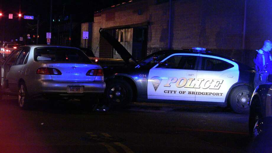 A Bridgeport police officer and the driver of another car were hospitalized Tuesday night, Dec. 11, 2012. Photo: Contributed Photo