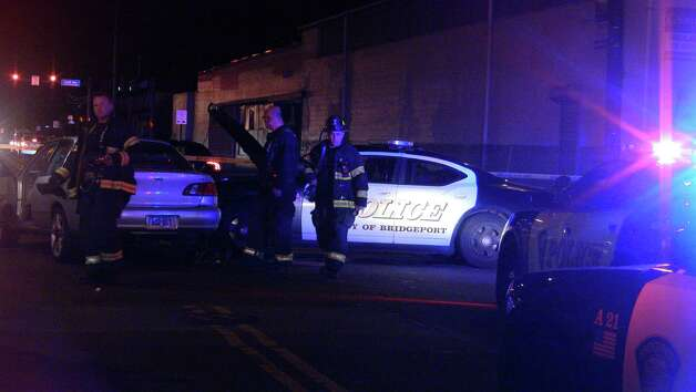 A Bridgeport police officer and the driver of another car were hospitalized Tuesday night, Dec. 11, 2012. Photo by Steve Krauchick/DoingitLocal.com Photo: Contributed Photo