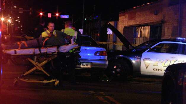A Bridgeport police officer and the driver of another car were hospitalized Tuesday night, Dec. 11, 2012. Photo by Steve Krauchick of Doingitlocal.com. Photo: Contributed Photo