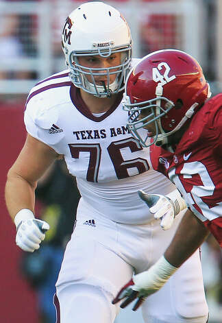Texas A&M offensive linesman Luke Joeckel (76) provides run blocking during the first quarter of a college football game against Alabama at Bryant-Denny Stadium, Saturday, Nov. 10, 2012, in Tuscaloosa. Photo: Karen Warren, Houston Chronicle / © 2012  Houston Chronicle