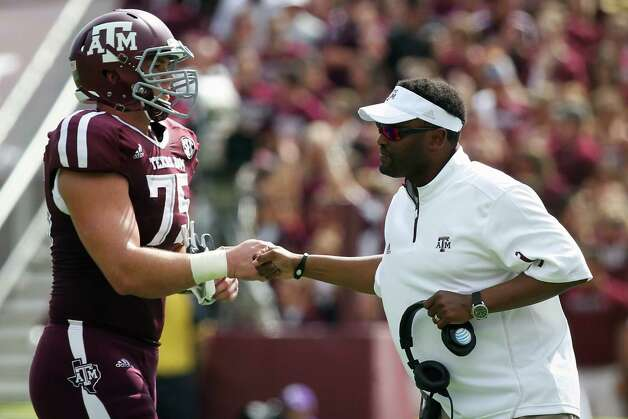 Texas A&M offensive linesman Jake Matthews (75) celebrates a score with head coach Kevin Sumlin quarter of a NCAA football game against LSU, Saturday, Oct. 20, 2012, in College Station. Photo: Nick De La Torre, Houston Chronicle / © 2012  Houston Chronicle