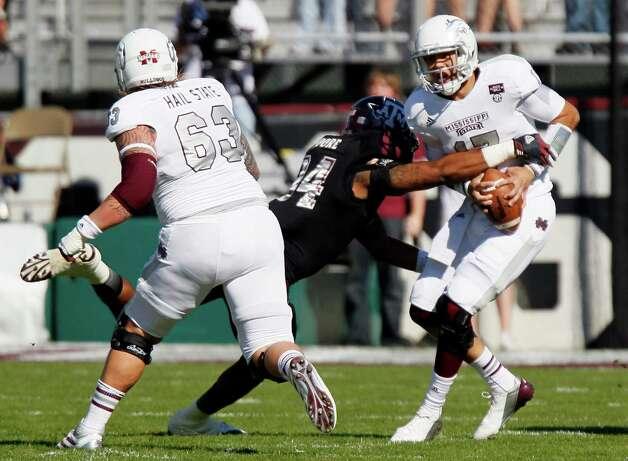 Texas A&M's Damontre Moore sacks Mississippi State's Tyler Russell in front of Dillon Day (63). Photo: Associated Press