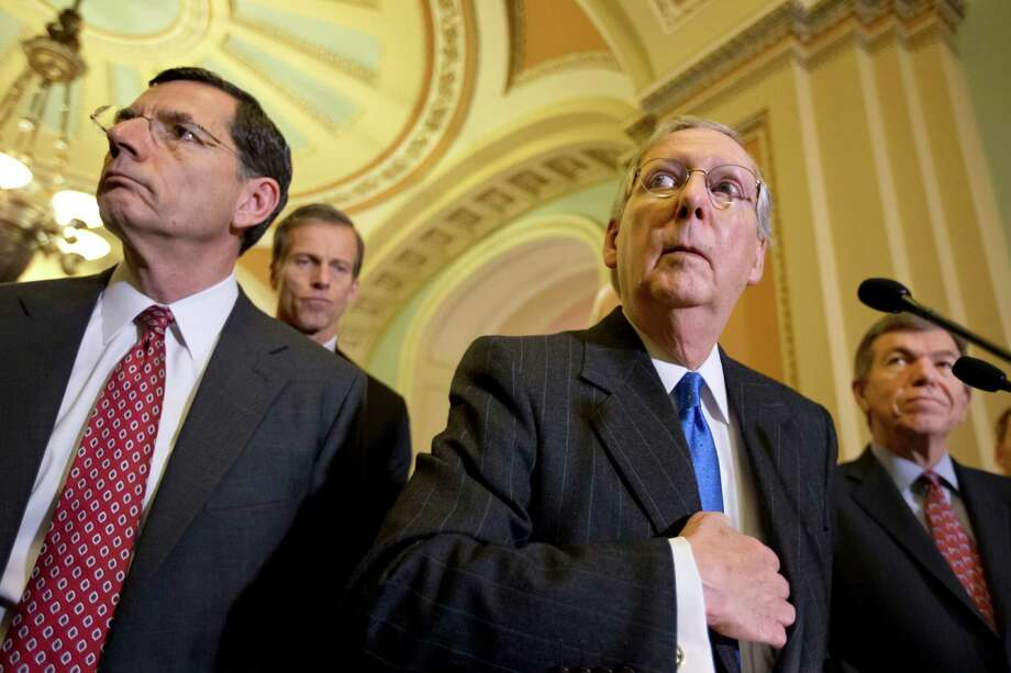 Senate Minority Leader Mitch McConnell, R-Ky., right, speaks with reporters following a GOP strategy session at the Capitol in Washington, Dec. 11, 2012, with from left, Sen. John Barrasso, R-Wyo., Sen. John Thune, R-S.D., and Sen. Roy Blunt, R-Mo.  (AP Photo/J. Scott Applewhite) Photo: J. Scott Applewhite, STF / AP