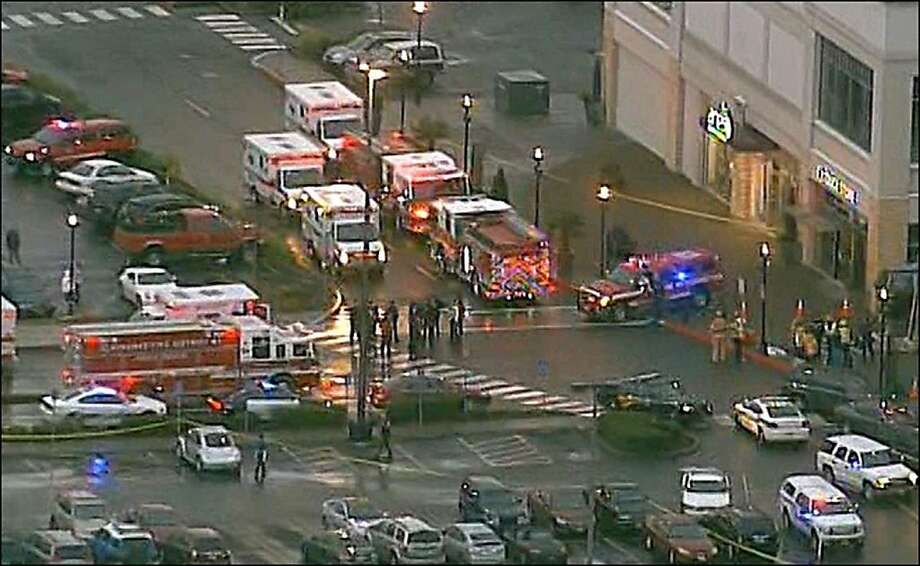 This still image from video courtesy of KATU.COM shows emergency vehicles after a shooting outside the Clackamas Town Center south of Portland, Oregon.   Two people were killed  when a gunman wearing body armor opened fire at a mall in the western US state of Oregon, witnesses and local media reported.  At least one other person was shot in Clackamas, south of Portland, according to The Oregonian newspaper, reporting a man brandishing a semiautomatic rifle near a branch of Macy's department store. Photo: -, AFP/Getty Images