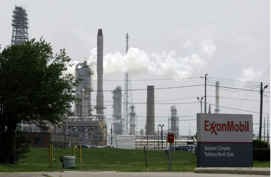 FILE - In this April 16, 2010 file  photo, steam rises from towers at an Exxon Mobil refinery in Baytown, Texas. Exxon says the energy renaissance in the U.S. will continue and predicts that North America will become a net exporter of oil and gas by the middle of the next decade.  The oil and gas giant's latest long-term energy outlook, released Tuesday, Dec. 11, 2012, says the rapid growth of production in the U.S., Canada along with improved energy efficiency will lead to more oil and gas being sent overseas.  (AP Photo/Pat Sullivan. File) Photo: Pat Sullivan