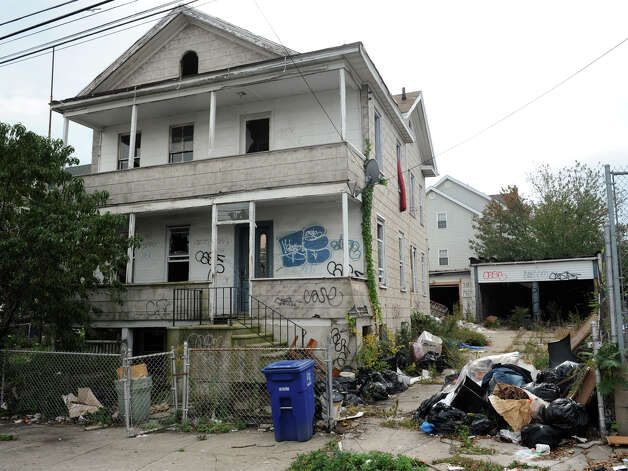 "121 George Street, in Bridgeport, Conn. Oct. 15th, 2012. The blighted property is the first targeted for cleanup as part of the city's ""Help Fight Blight"" campaign. Photo: Ned Gerard / Connecticut Post"