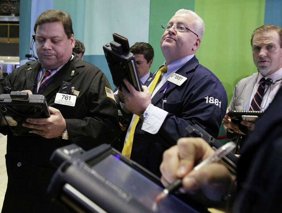 Traders work on the floor of the New York Stock Exchange Tuesday, Dec. 11, 2012. Stocks opened higher Tuesday ahead of a meeting of the Federal Reserve and possible additional steps to bolster the U.S. economy.  (AP Photo/Richard Drew) Photo: Richard Drew
