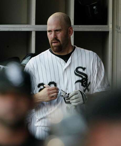 Chicago White Sox's Kevin Youkilis watches teammates play during the first inning of a baseball game against the Toronto Blue Jays in Chicago, Friday, July 6, 2012. (AP Photo/Nam Y. Huh) Photo: Nam Y. Huh, STF / AP