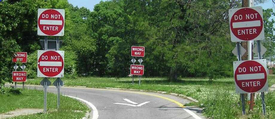 This undated handout photo provided by the New York State Department of Transportation shows double-posted ?Do Not Enter? and ?Wrong Way? signs on an exit ramp. Hundreds of people are killed each a year when drivers turn the wrong-way into the face of oncoming traffic on high-speed highways, and a majority of the crashes involves drivers with blood alcohol levels more than twice the legal limit, a federal accident researcher said Tuesday. (AP Photo/New York State Department of Transportation ) Photo: HO / New York State Department of Tra